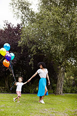 Mother, son and balloons.