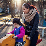 Mother and child at playground.