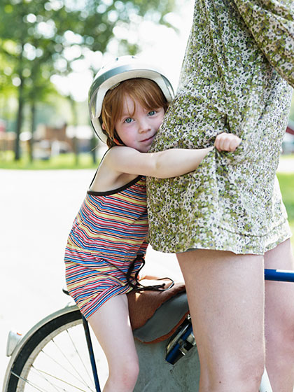 Girl and mother on bicycle.